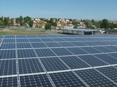 Solar canopies at Caroline Davis Intermediate School generate electricity and provide shaded parking.