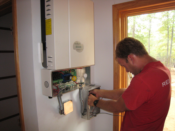 String inverters are usually mounted on a wall easily accessible for repairs if a string goes down.