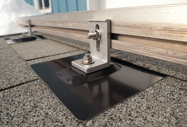 QUICK CONNECTION  The QuikFoot product has a baseplate that is fastened to the roof with a flashing over top. All EcoFasten mounting hardware is watertight and secure.