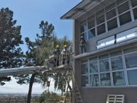 The 198-panel system is generating close to 250 kWh, which could save the school about $15,000 per year.