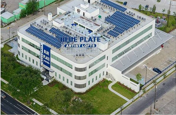 The historic Blue Plate mayonnaise factory has been converted into energy-efficient apartments for artists. Powered by a 63kW system with MAGE POWERTEC PLUS modules the tenants are enjoying reduced utility costs. © MAGE SOLAR