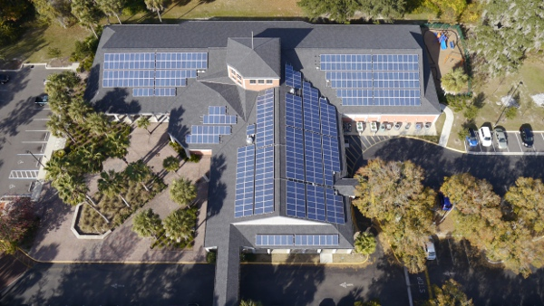 Solar Impact has worked on roof lease plans for public schools and libraries throughout the Gainesville-area — including this 100-kW installation at the Millhopper Branch Library.