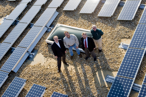 In 2008, Standard Solar signs its first PPA with Kelly Electric in Washington, D.C., for a 150-kW rooftop system (CEO Tony Clifford is second from right).