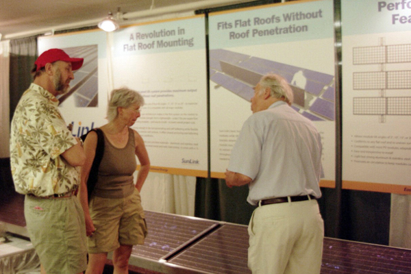 "SunLink founder John Eastwood talks to customers at a 2004 ASES show, which he recalls was held in a ""hotel garage in Portland."""