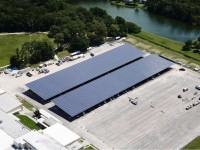 Caption: Lockheed Martin and Advanced Green Technologies have completed half of the huge solar carport project, allowing employees to enjoy a little shade during the summer.