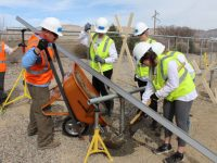 Beloit University students help install community solar array in Colorado.