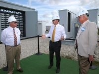DeSoto County Commission Chairman Jim Selph (left), Florida Power & Light Company (FPL) President and CEO Eric Silagy and DeSoto County Commissioner Terry Hill discuss the company's new battery storage technology at the FPL Citrus Solar Energy Center in DeSoto County, Fla., Feb. 9, 2018. During the commissioning of the company's third and newest solar power plant in DeSoto County - FPL Wildflower Solar Energy Center - the company unveiled what is believed to be the country's first-of-its-kind solar-plus-battery storage system that increases the amount of energy a solar plant delivers to the grid. Photo credit: Alex Menendez for FPL. (PRNewsfoto/Florida Power & Light Company)