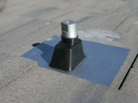 This solar mounting system from SunModo anchors entirely above roof tiles