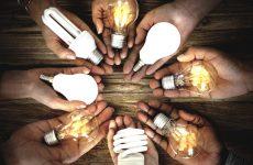 Hands Show Light Bulb Ideas Together Partnership