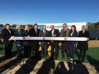 Elected Officials and project partners mark the occasion with a ribbon cutting.  Pictured (L-R): City Councilor Stephen McCallister; RI DEM Director Janet Coit; Senator Erin Lynch Prata; Senate Majority Leader Michael McCaffrey; Southern Sky President Ralph A. Palumbo; Mayor Joseph Solomon; Michael Integlia; Southern Sky Vice President Lindsay McGovern; and RI OER Commissioner Carol Grant.