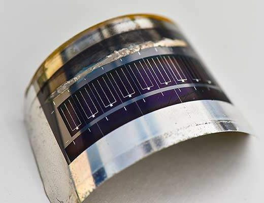 This lightweight CIGS photovoltaic cell, on flexible stainless steel, was made by Matthew Reese and his team at NREL. Photo by Dennis Schroeder / NREL