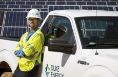 Employee Shawn Dwyer (371846) standing next to truck in front of solar panels at Halifax Solar Facility. Roanoke Rapids, NC. North Carolina.