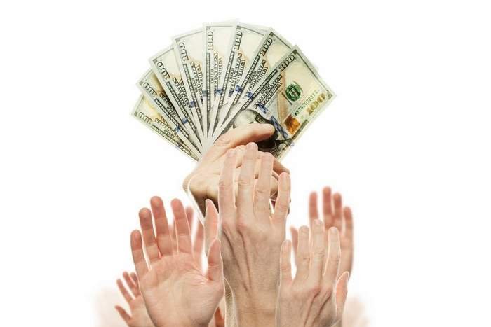 US dollars cash money and many people hands. Commercial money in