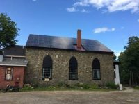 New Hampshire's Stone Church Music Club will save $100,000 over 20 years thanks to solar system