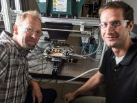 Scientists John Geisz (left) and Ryan France fabricated a solar cell that is nearly 50% efficient. Photo by Dennis Schroeder, NREL