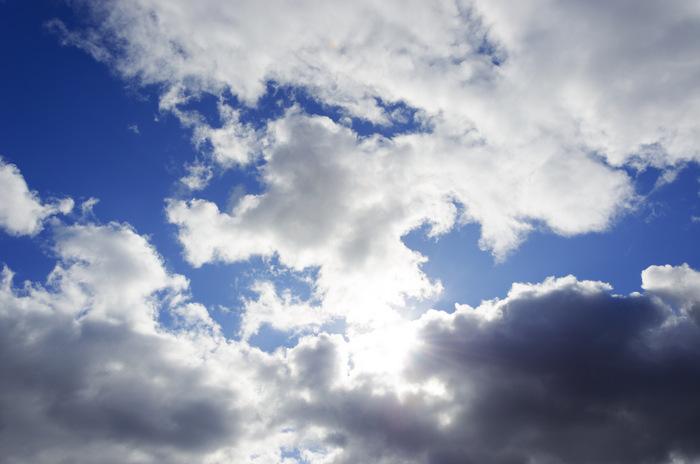 sun peeks through clouds