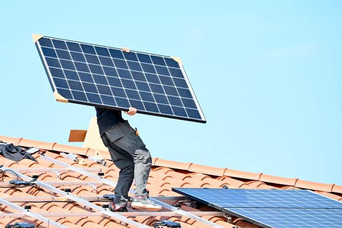 solar worker on rooftop