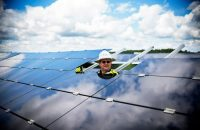 Employee installing solar panel