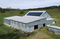 Drone aerial photograph of Sunflare solar panel installation on the McBride family farm horse barn.